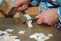 1. The wood-shingles covering the roof of many clocks are cut.
